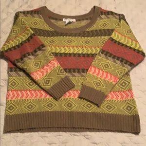 Like new sweater. No pulls- pink yellow and purple